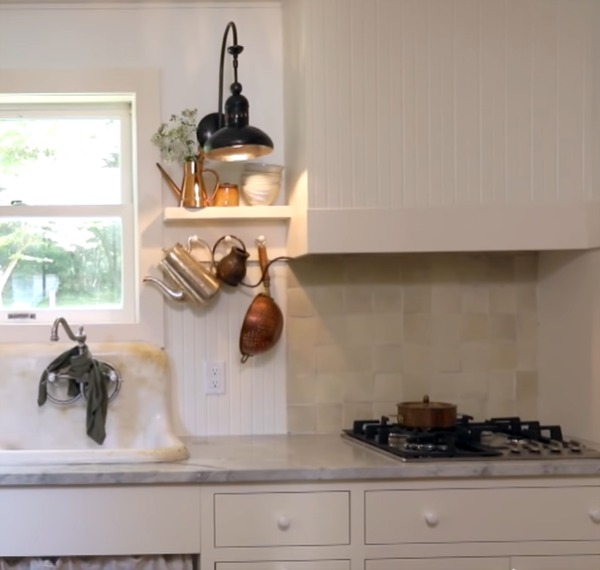 Zellige tile backsplash in a charming Shaker style kitchen in a cottage renovated on Restored by the Fords. #thesmithproject #leanneford #kitchendesign #rustickitchen #farmhousekitchen