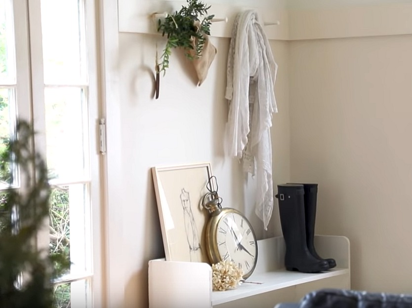 Shaker style peg rail above a vintage white wood bench in a cottage's entry. Renovation by Leanne Ford on Restored by the Fords - The Smith Project. #leanneford #entry #shakerstyle #cottagestyle
