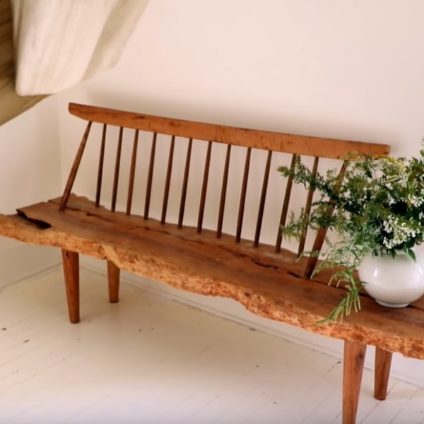 Steal Leanne Ford's paint colors and ideas for gorgeous Shaker style like this wood bench with live edge seat in a cottage with white painted hardwood floors and design by Leanne Ford. #leanneford #interiordesign #shakerstyle #benches #farmhousestyle