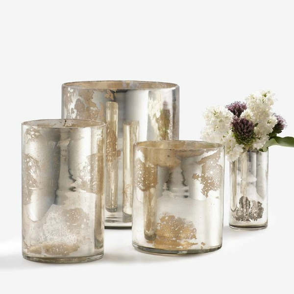 Set of varying sized mercury glass (or antiqued silver glass) cylinder vases or candle holders.