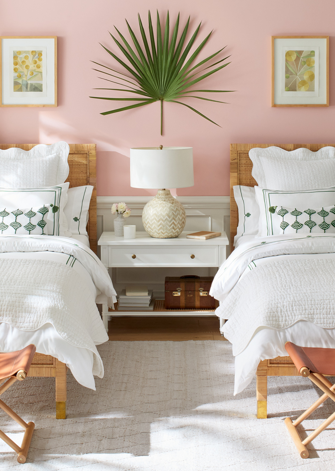 Pretty and classic coastal bedroom with candy pink wall, rattan beds, adn white bedding - Serena & Lily. #coastalcottage #bedroomfurniture #pinkbedrooms
