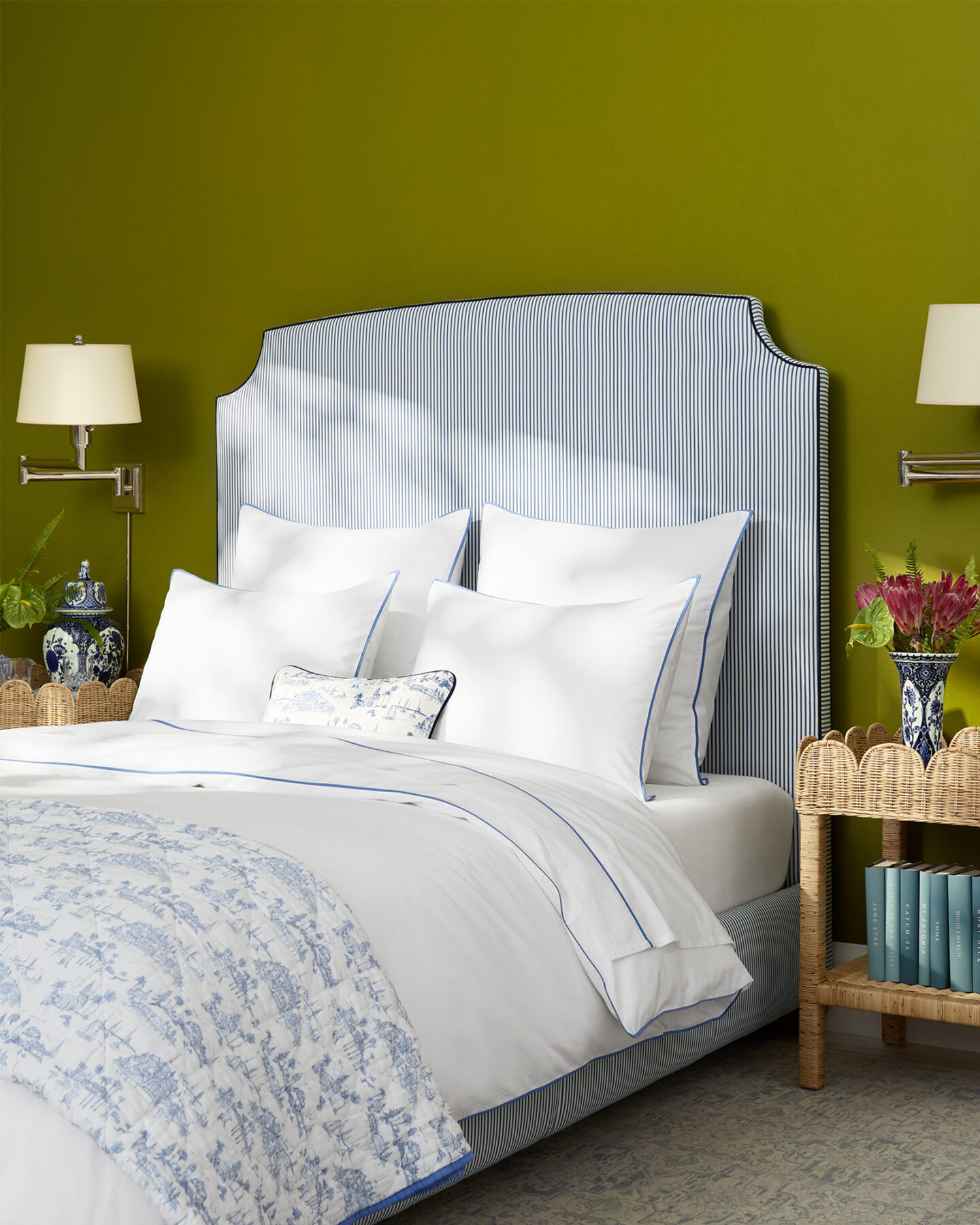Charming coastal bedroom with French blue pinstripe bed and sophisticated chartreuse wall color.