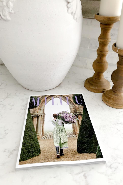 Milieu magazine (Spring 2021) on my kitchen counter (Viatera Minuet white quartz) with urn and candle holders - Hello Lovely Studio. #viateraquartz #minuet #milieu #modernfrench