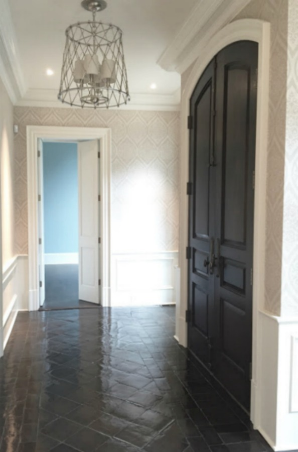 Dark stained terracotta tile floor in an entry - design by Sherry Hart. #entry #terracottatile #tilefloor #interiordesign