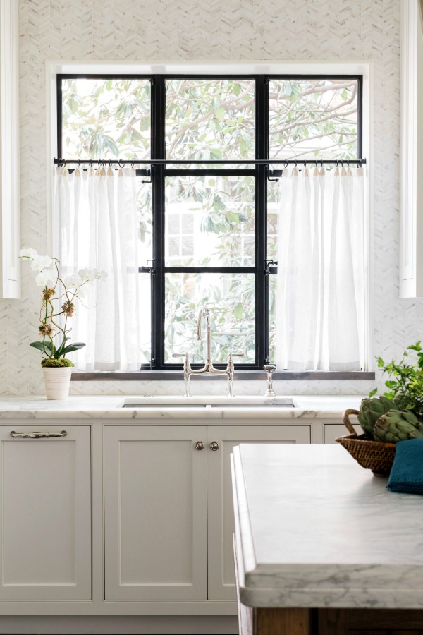 Classic and luxurious white kitchen designed by Sherry Hart for the Brookhaven project. #whitekitchen #kitchendesign #classickitchen #traditionalkitchen