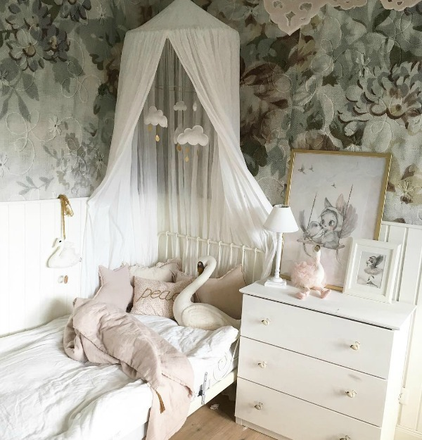 Serene and ethereal little girl's bedroom with bold floral wallpaper and hushed palette - Villa Jenal. #bedroomdesign #girlsbedroom #romanticbedroom #frenchnordic