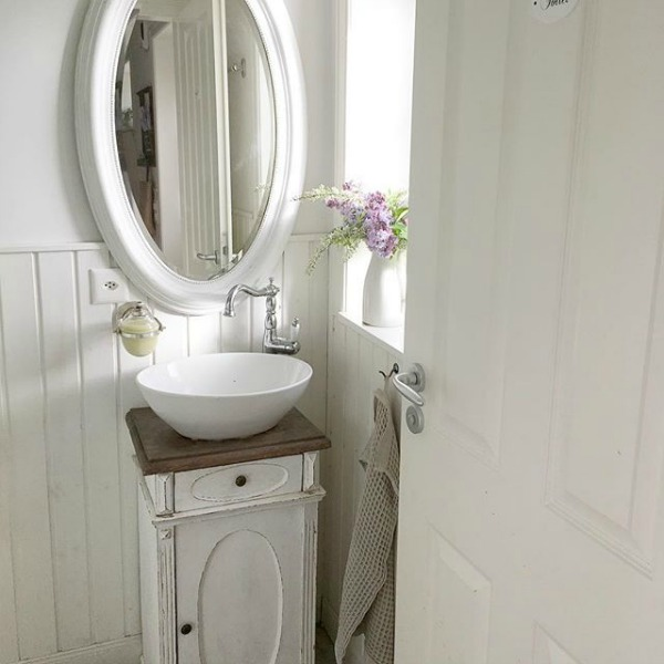 Charming French Nordic small powder bath with vessel sink and all white decor - Villa Jenal. #swedishstyle #frenchnordicliving #bathroomdesign #scandistyle