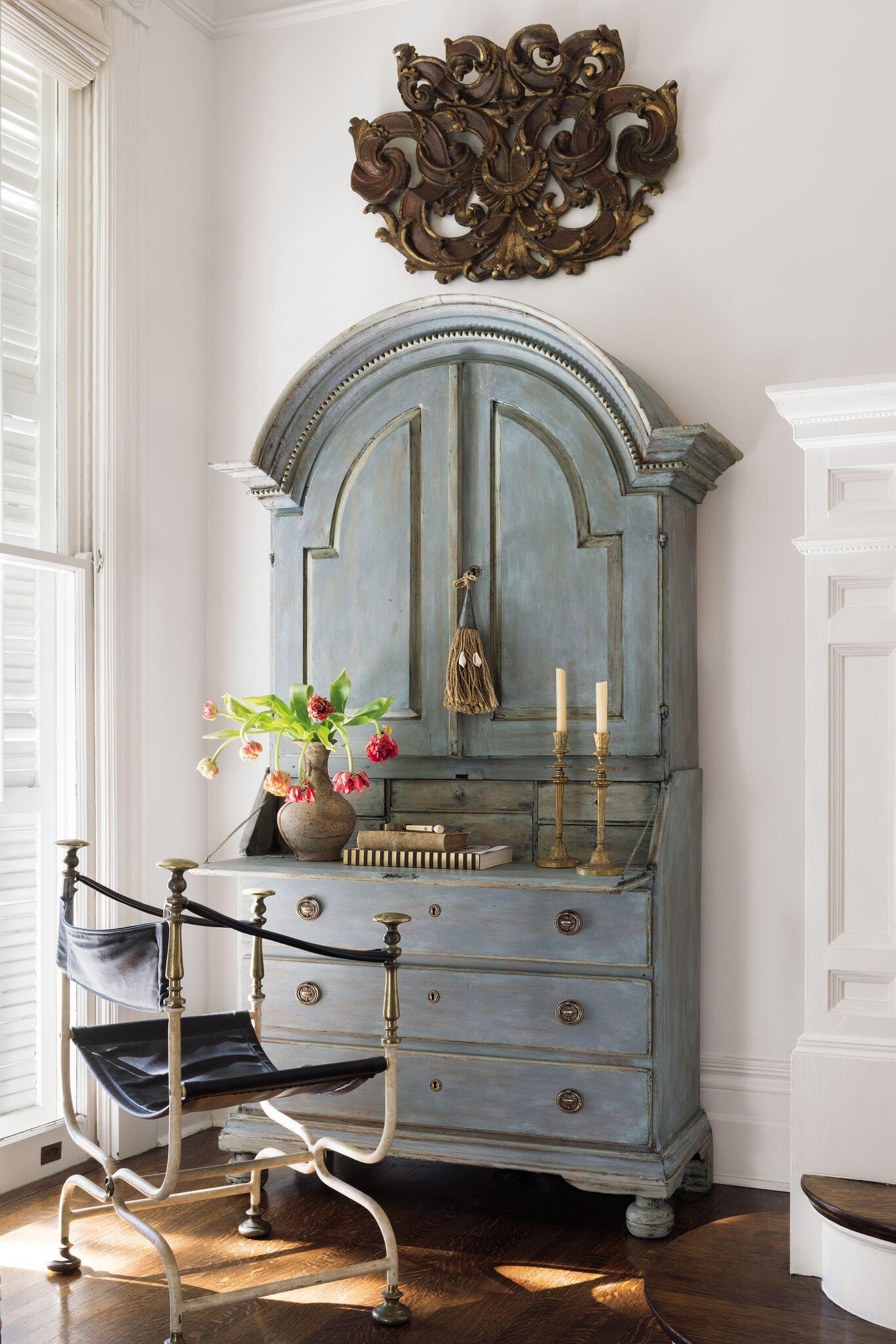 Beautiful blue 18th century Swedish secretary and vintage Savonarola chair make a stair landing functional for storage and correspondence. Tara Shaw designed this space. #tarashaw #swedishsecretary #swedishantiques #interiordesign #oldworldstyle #traditionaldecor