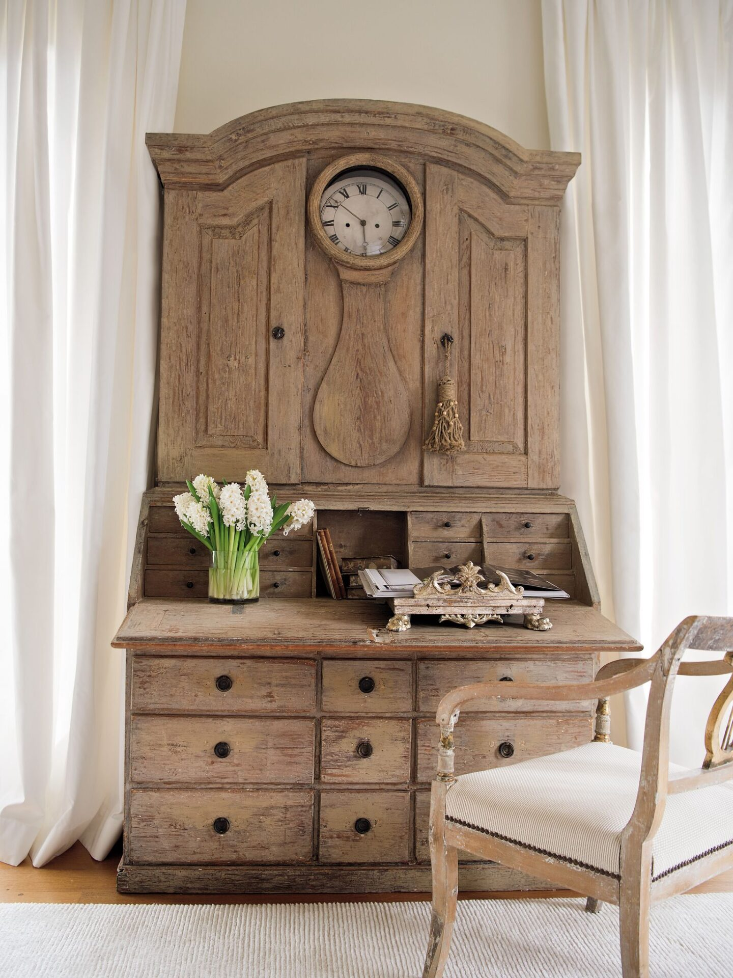 An 18th century clock secretary in a Tara Shaw designed guest room has breathtaking patina and functions for modern life. #tarashaw #swedishantiques #europeanantiques #swedishsecretary #18thcentury #oldworldstyle #elegantdecor