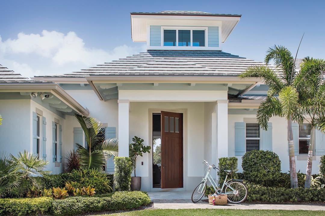 Palm Beach home with adorable light blue beachy shutters. Charming inspiration if you love white painted house exteriors! #whitehouses #housedesign #exteriors #whitecottages #beachhouse