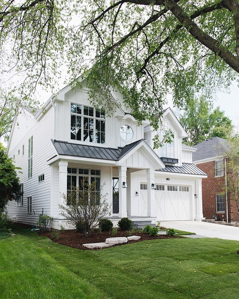 Charming white traditional home by M House Development. Paint color is Farrow & Ball All White. Charming inspiration if you love white painted house exteriors! #whitehouses #housedesign #exteriors #farrowandballallwhite