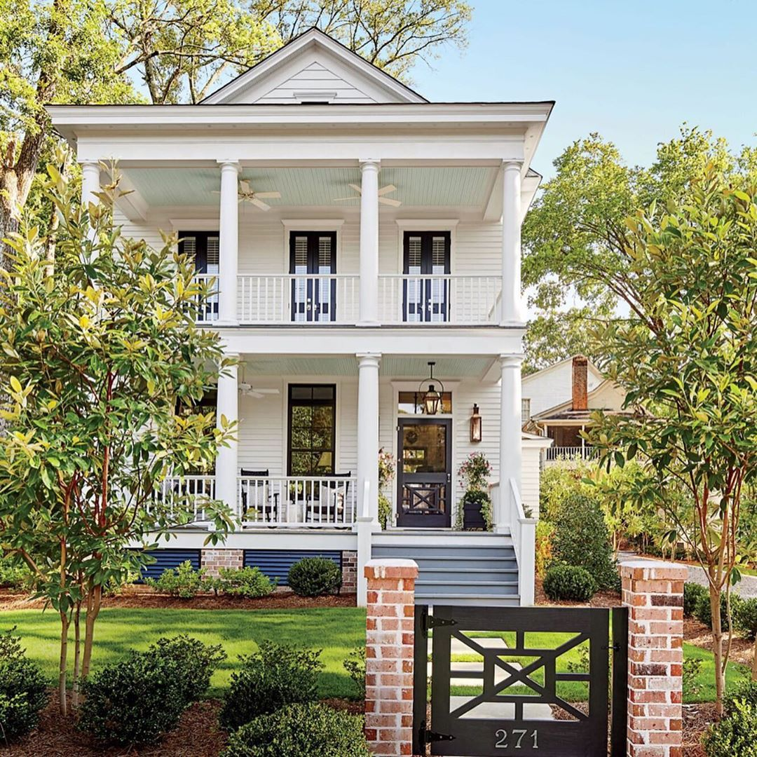Gorgeous Southern plantation style home with front porches - Southern Living Magazine. Charming inspiration if you love white painted house exteriors! #whitehouses #housedesign #exteriors #designinspiration