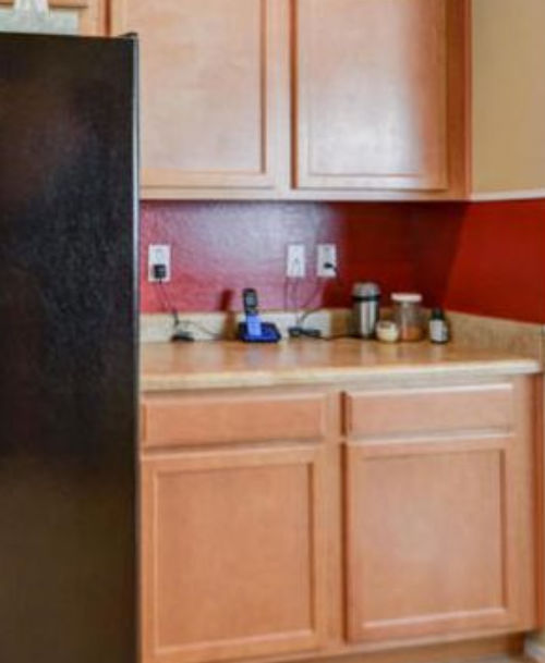 before photo of Arizona kitchen with red backsplash