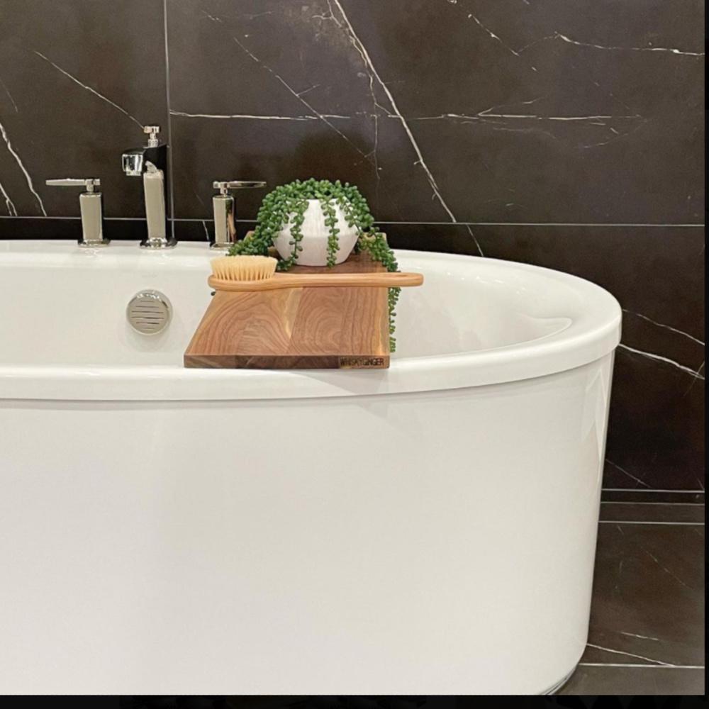 Black marble in a bathroom with soaking tub and wood board - @refineddesignstagingllc. #bathroomdesign #blackandwhite #blackmarble