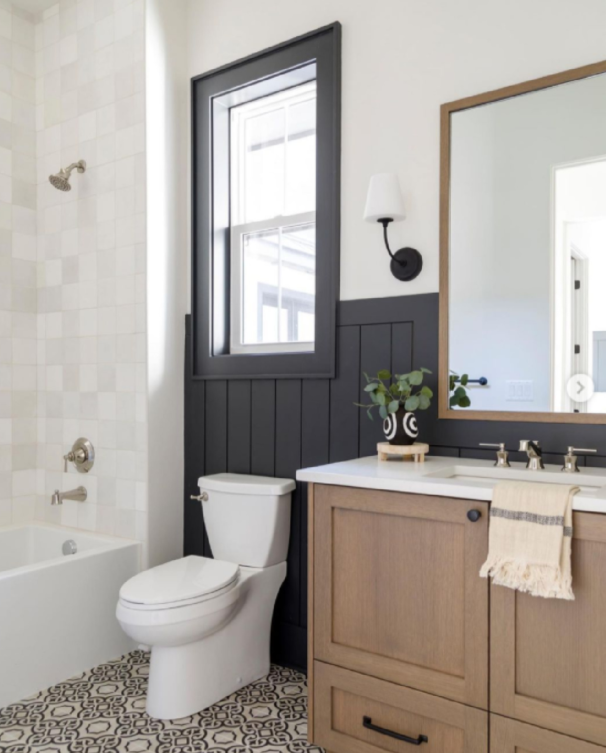 Black and white bathroom design with natural wood vanity and zellige tiles - design by Judith Balis. #blackandwhite #bathroomdesign #bathroomdecor