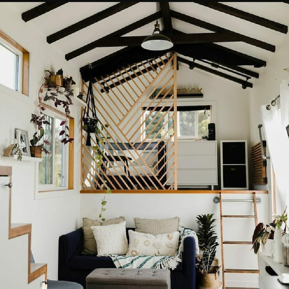 Beachy boho black and white tiny house interior in a shipping container in Maui - @zeena_fontanilla. #tinyhouse #shippingcontainer #blackandwhite