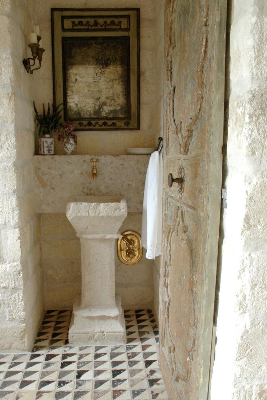 Reclaimed stone, antique doors and mantels, and one of a kind architectural elements. #housetour #frenchcountry #frenchfarmhouse #europeanfarmhouse #chateaudomingue #rusticdecor #pamelapierce #elegantdecor #bathroom #antiques #stone