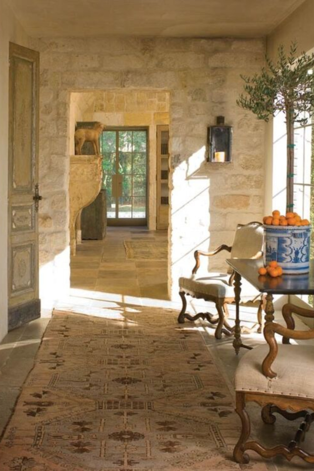 Chateau Domingue Timeless European Elegance and French farmhouse style converge in this house tour of founder Ruth Gay's home on Hello Lovely. Reclaimed stone, antique doors and mantels, and one of a kind architectural elements. #housetour #frenchcountry #frenchfarmhouse #europeanfarmhouse #chateaudomingue #rusticdecor #pamelapierce #elegantdecor #antiques