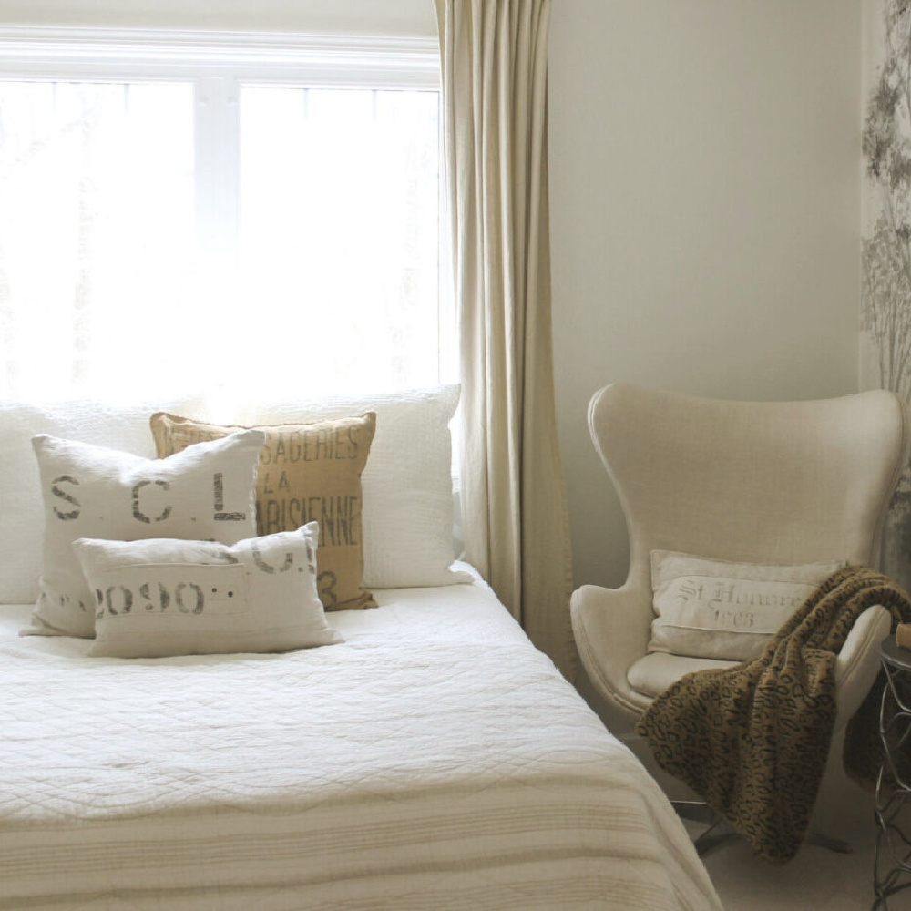 Belgian linen and European country style in a guest bedroom with egg chair - Hello Lovely Studio. #eggchair #belgianlinen #copenhagenchair