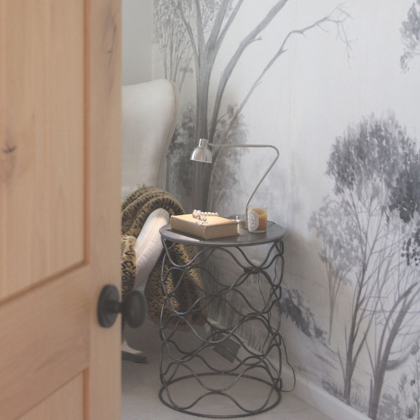 Subdued, understated, and serene, a tone on tone wall covering with gray trees sets a calm tone in a bedroom - Hello Lovely Studio. #wallcovering #photowall #treewallpaper #hellolovelystudio