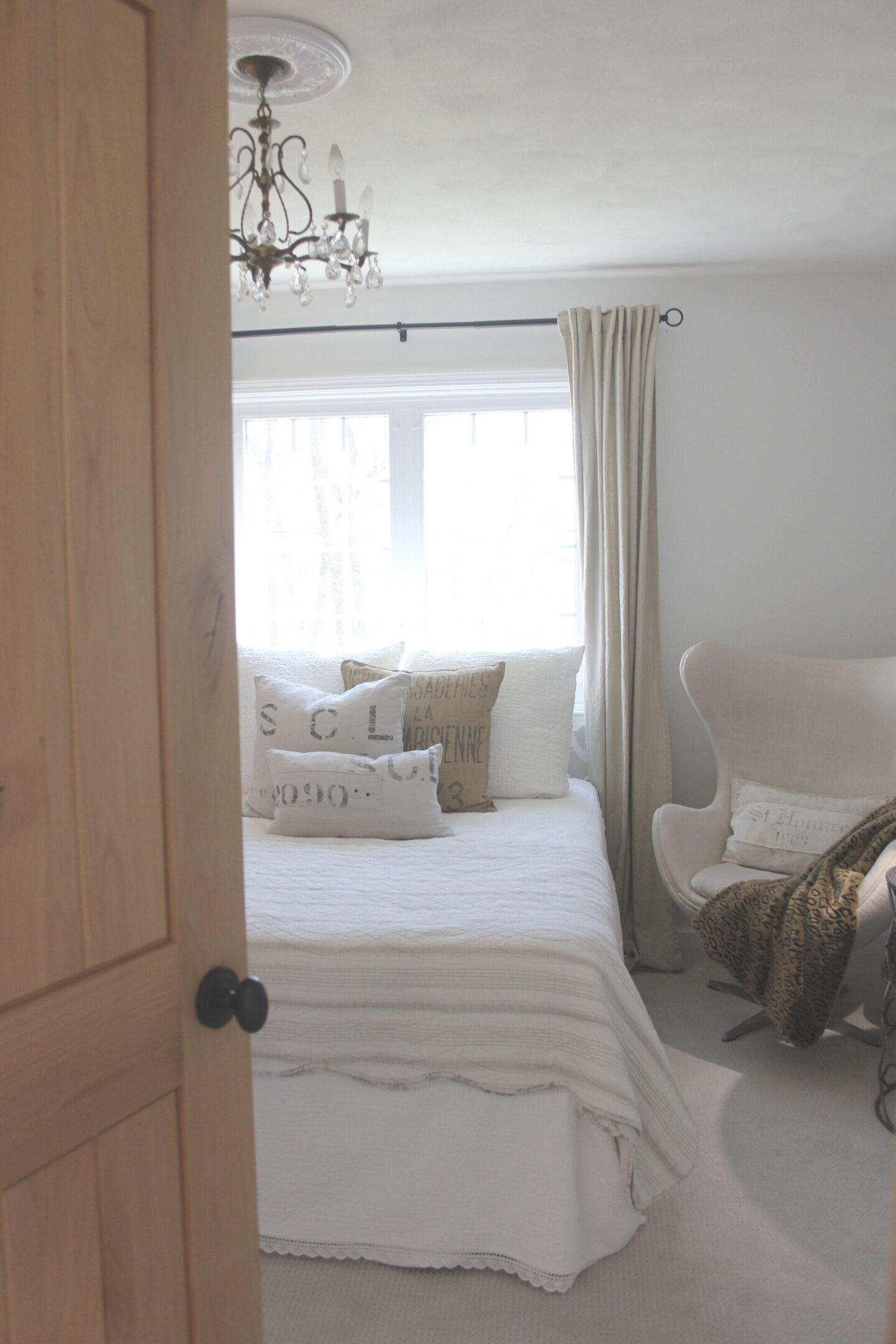 Calm, simple, neutral white bedroom at our fixer upper painted Benjamin Moore White - Hello Lovely Studio. #alderdoor #interiordesign #bedroom