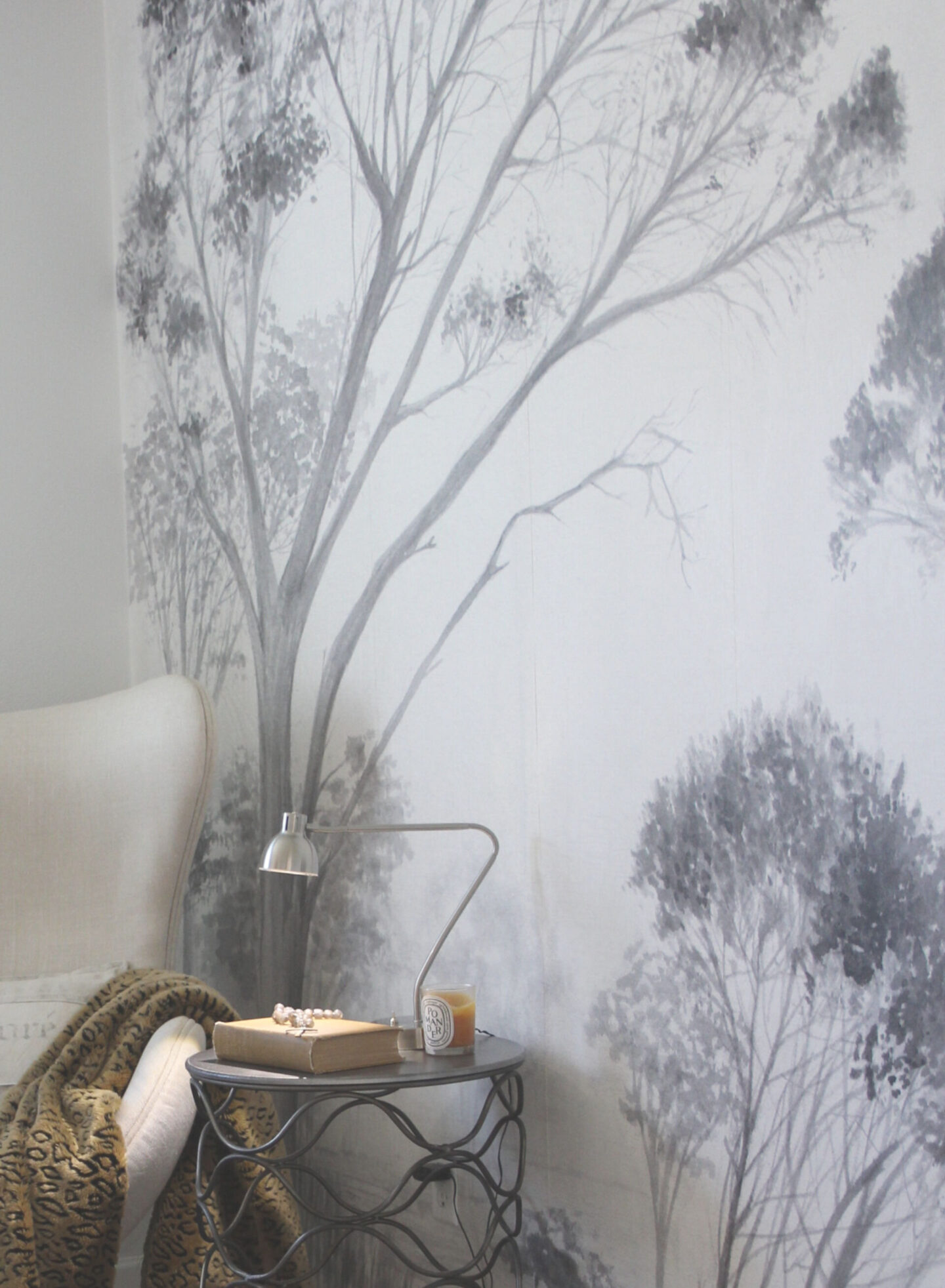 Subdued, understated, and serene, a tone on tone wall covering with gray trees sets a calm tone in a bedroom - Hello Lovely Studio. Ready to learn how to decorate chic yet cheap? #wallcovering #photowall #treewallpaper #hellolovelystudio
