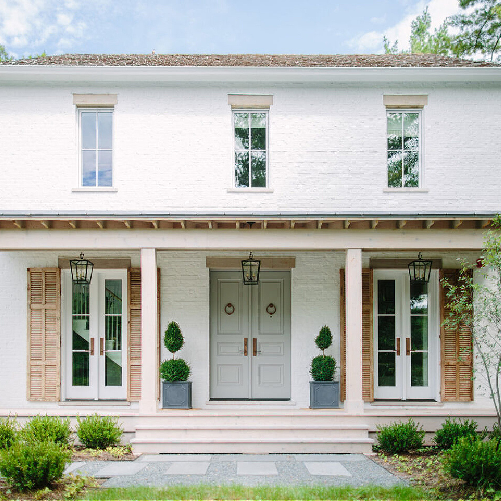 Gorgeous white painted brick exterior on a traditional farmhouse with design by Kate Marker in Barrington, IL. #whitebrick #houseexteriors #katemarker