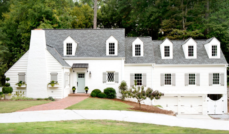 Beautiful white brick cottage painted Sherwin Williams Alabaster - Huff Harrington, Ladisic. #whitecottage #sherwinwilliamsalabaster #houseexterior #paintcolors