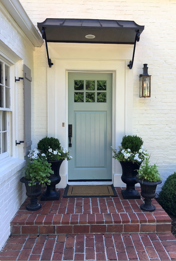 Benjamin Moore Wythe Blue front door on a beautiful white (SW Alabaster) brick home - built by Michael Ladisic. #benjaminmoorewytheblue #paintcolors #frontdoor