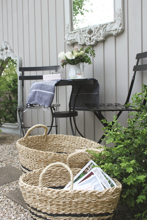 French country seagrass baskets with Frenchie black stripes are perfect for stowing summer essentials inside and out. #seagrassbaskets #frenchbaskets #homedecor #baskets #frenchcountrydecor #modernfrench #hellolovelystudio