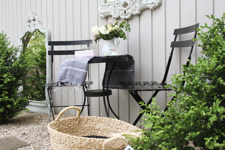 Parisian Café Chairs and baskets to stow summer essentials inside and out. #cafechairs #bistrochairs #frenchcountry #outdoorfurniture #seagrassbaskets #frenchbaskets #homedecor #modernfrench #hellolovelystudio