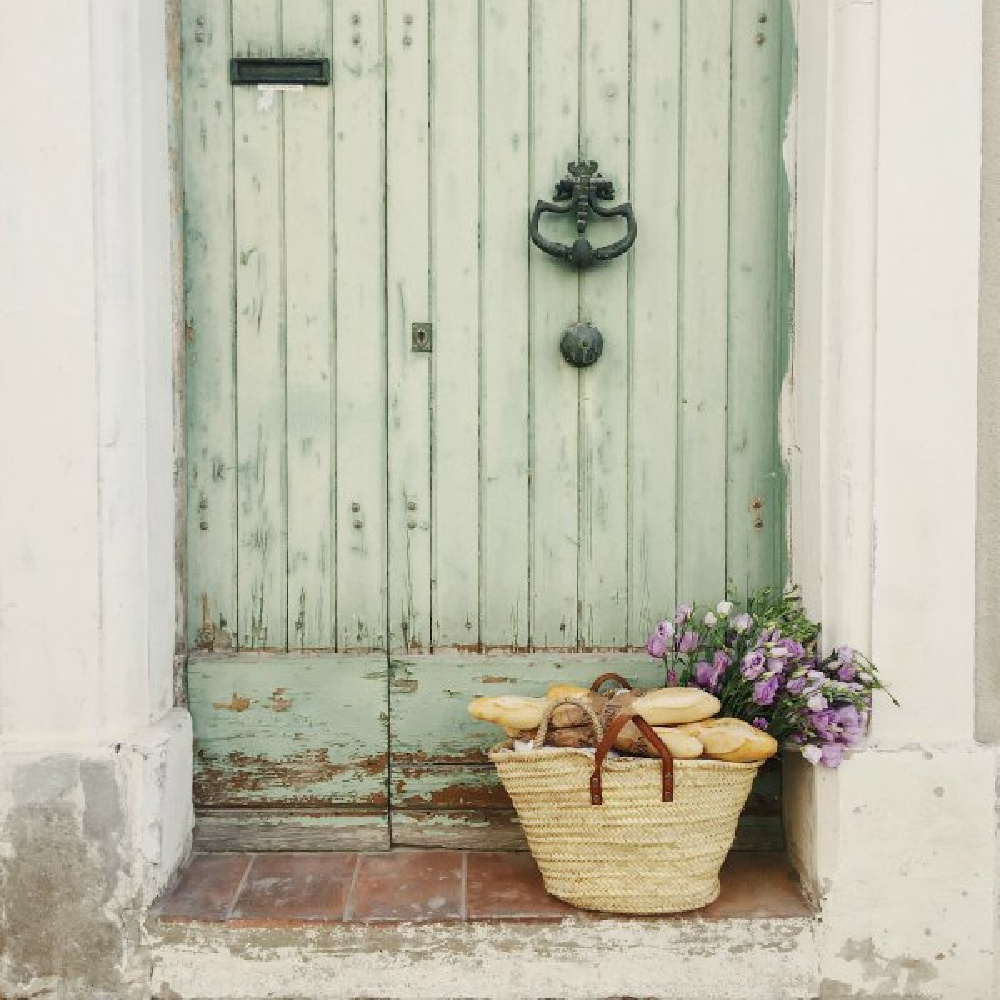 Rustic and charming weathered French green door! French farmhouse design inspiration with an interview with Vivi et Margot. Come be inspired on Hello Lovely and learn the paint colors used in these beautiful authentic French country interiors. #frenchfarmhouse #hellolovelystudio #frenchcountry #designinspiration #interiordesign #housetour #vivietmargot #rusticdecor #frenchhome #authentic #frenchmarket #summerliving #bordeaux #westernfrance #europeanfarmhouse