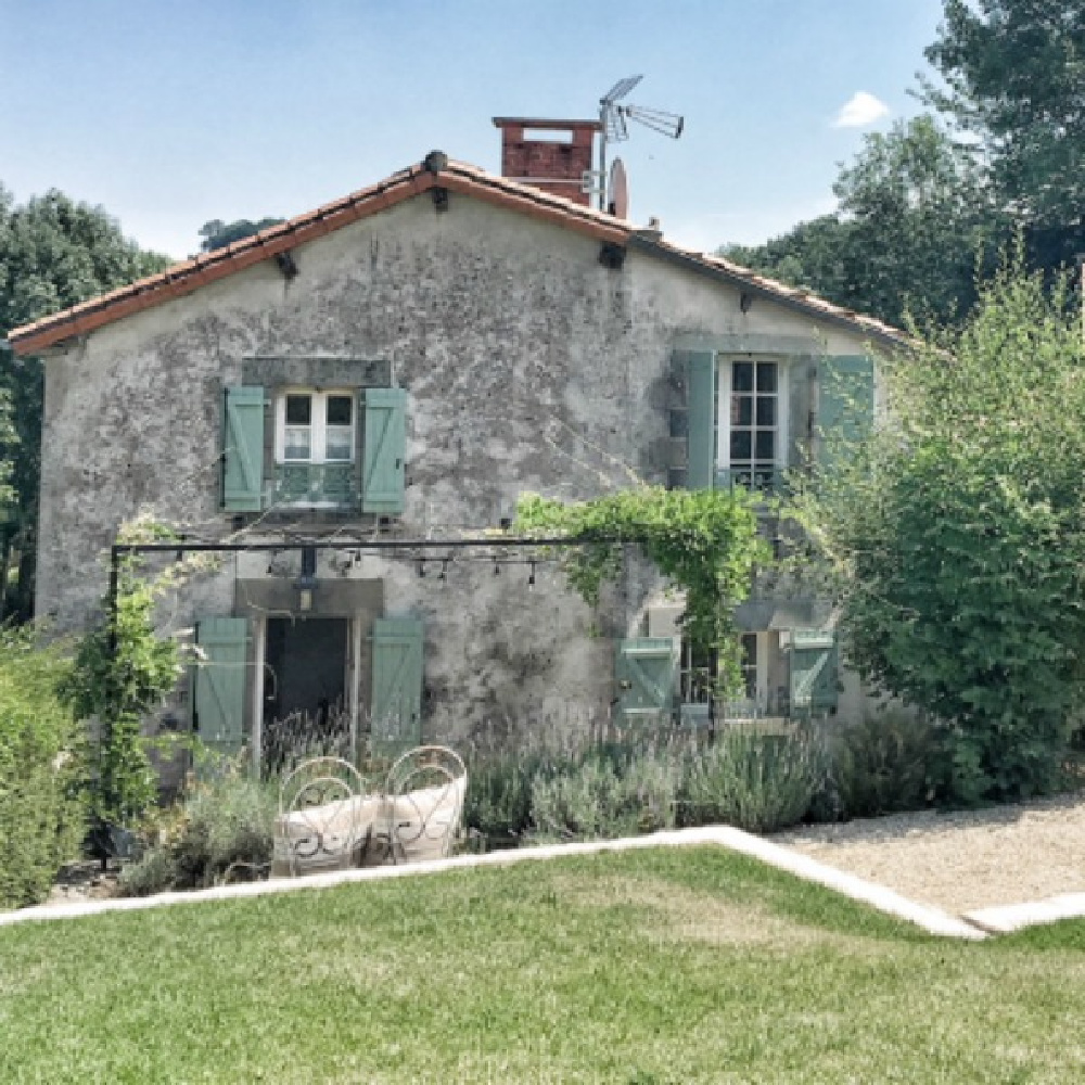 Breathtaking farmhouse exterior in France with green shutters. French farmhouse design inspiration, house tour -Vivi et Margot. Come be inspired and learn the paint colors used in these beautiful authentic French country interiors. #frenchfarmhouse #hellolovelystudio #frenchcountry #designinspiration #interiordesign #houseexterior #vivietmargot #rusticdecor #frenchhome#europeanfarmhouse