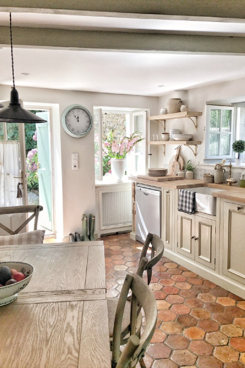 Charming French kitchen with reclaimed terracotta tile floor. French farmhouse design inspiration with an interview with Vivi et Margot. Come be inspired on Hello Lovely and learn the paint colors used in these beautiful authentic French country interiors. #frenchkitchen #frenchfarmhouse #hellolovelystudio #frenchcountry #designinspiration #interiordesign #vivietmargot #rusticdecor #frenchhome #summerliving #bordeaux #europeanfarmhouse
