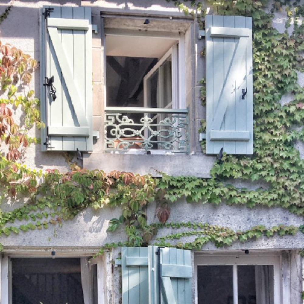 Climbing vines and green shutters on an authentic French farmhouse by Vivi et Margot. #frenchfarmhouse #exterior #vivietmargot #greenshutters #frenchcountry #rusticdecor #farmhouse #provence #southoffrance