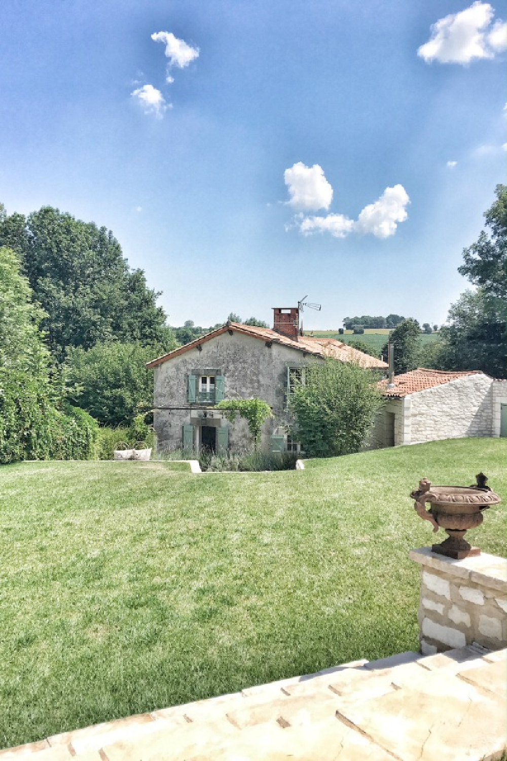 Rustic stone farmhouse with green shutters in French countryside. #vivietmargot #frenchfarmhouse #exterior #farmhouse #houseinFrance #romantichouse #southoffrance #provenceinspiration #greenshutters