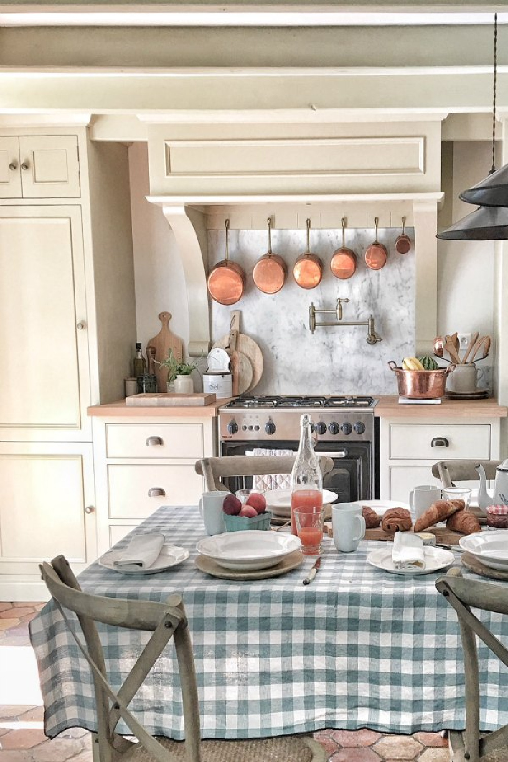French kitchen with limestone colored painted cabinets, wood countertop, modern range, and romantic linens from Vivi et Margot. #frenchkitchen #frenchfarmhouse #kitchendesign #romantickitchen #interiordesign #kitchendesign