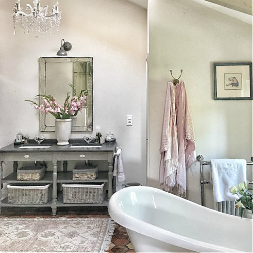Rustic elegant bathroom in France.  You'll love this photo gallery and house tour of a home near Bordeaux, France. #vivietmargot #frenchfarmhouse #rusticdecor #countryfrench #interiordesign #bathroomdecor