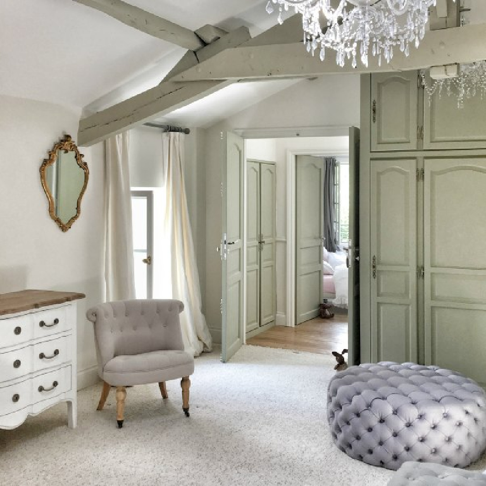 Farrow and Ball French Gray  painted cabinets in French bedroom. Come discover beautiful French farmhouse design inspiration, house tour, French homewares and market baskets from Vivi et Margot. Photos by Charlotte Reiss. Come be inspired on Hello Lovely and learn the paint colors used in these beautiful authentic French country interiors. #frenchfarmhouse #hellolovelystudio #frenchcountry #designinspiration #interiordesign #vivietmargot #farrowandballfrenchgray