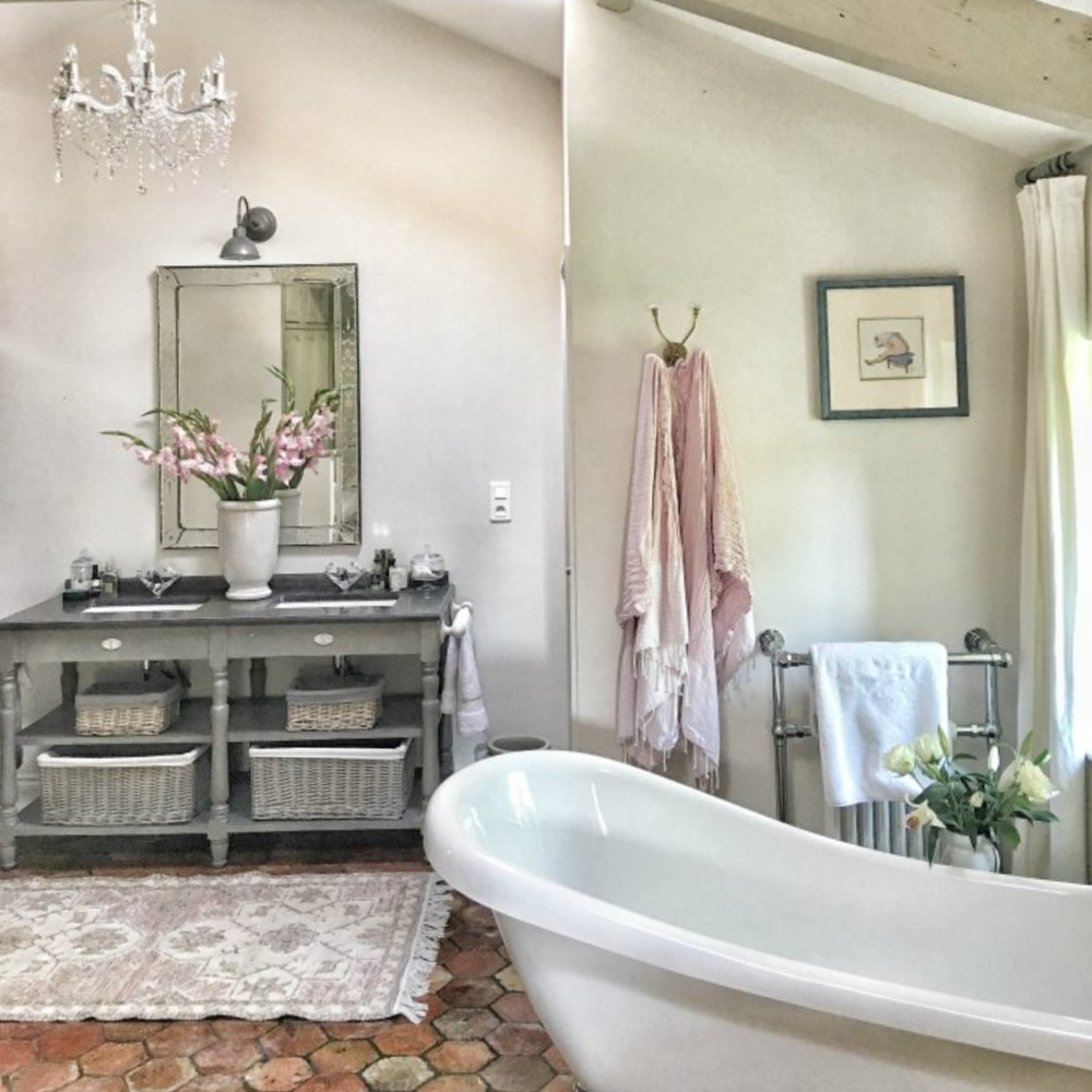 Rustic, serene, and Old World bathroom in a country house near Bordeaux, France. #bathroomdesign #oldworldstyle #frenchfarmhouse #interiordesign
