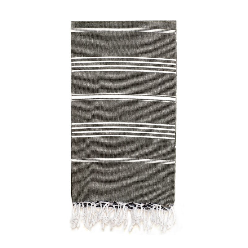 This faded black stripe Turkish cotton towel with fringe can be used so many different ways! As a beach towel, in the bath, on the table, or as a throw. #turkishtowels #rusticdecor #homedecor #bathtowels #beachtowels #blackandwhite #stripetowels