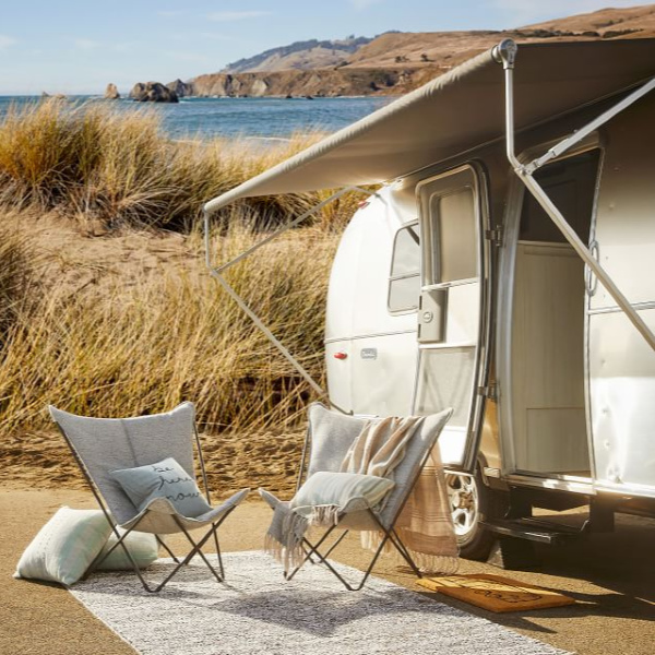 Blissful and serene camping scene. Airstream at Pottery Barn is a lovely collection of whimsical and happy camper decor whether we have a vintage camper to put in or not! #airstream #potterybarn #happycamper #whimsicalgifts #vintagecamper #homedecor