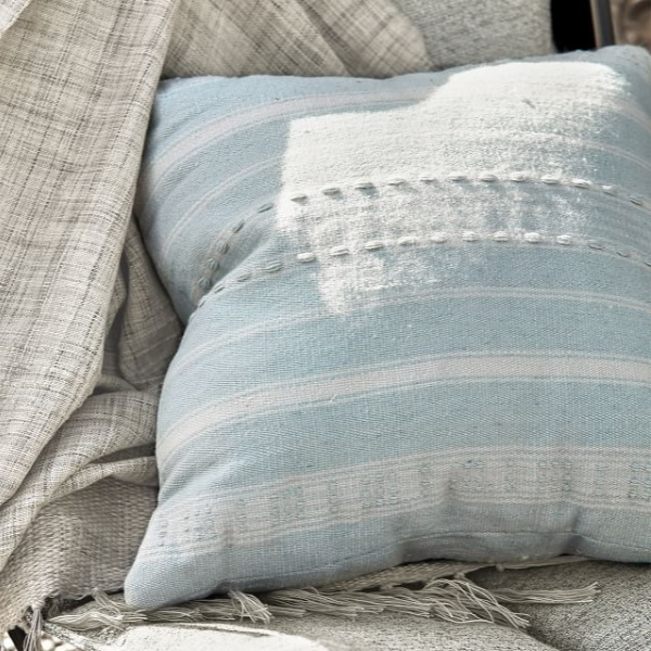 Light blue pillow. Airstream at Pottery Barn is a lovely collection of whimsical and happy camper decor whether we have a vintage camper to put in or not! #airstream #potterybarn #happycamper #whimsicalgifts #vintagecamper #homedecor