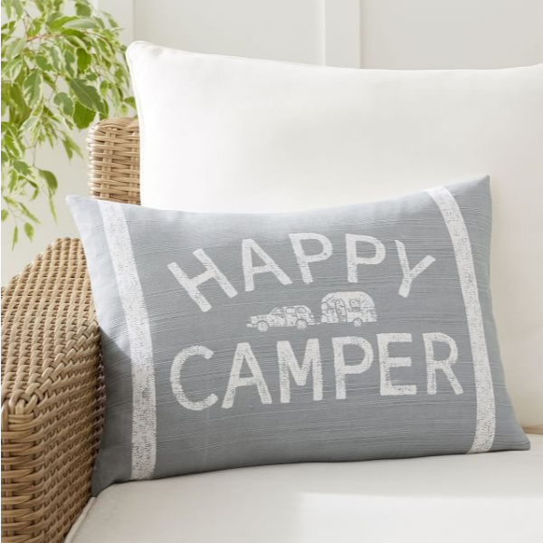 Happy Camper pillow. Airstream at Pottery Barn is a lovely collection of whimsical and happy camper decor whether we have a vintage camper to put in or not! #airstream #potterybarn #happycamper #whimsicalgifts #vintagecamper #homedecor