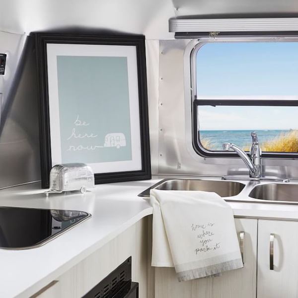 Be Here Now print. Airstream at Pottery Barn is a lovely collection of whimsical and happy camper decor whether we have a vintage camper to put in or not! #airstream #potterybarn #happycamper #whimsicalgifts #vintagecamper #homedecor #beherenow #print