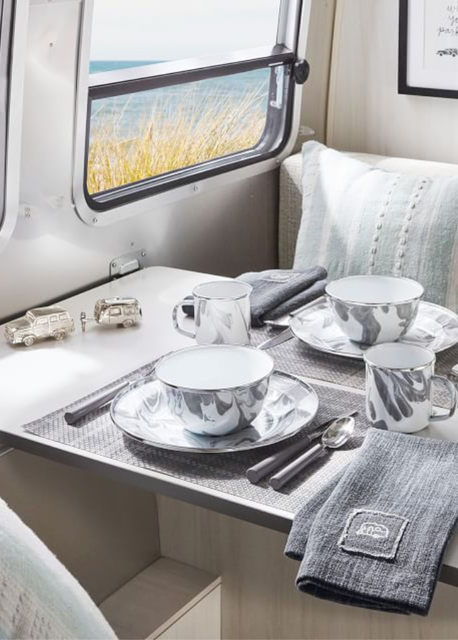 Marbled grey dishes. Airstream at Pottery Barn is a lovely collection of whimsical and happy camper decor whether we have a vintage camper to put in or not! #airstream #potterybarn #happycamper #whimsicalgifts #vintagecamper #homedecor