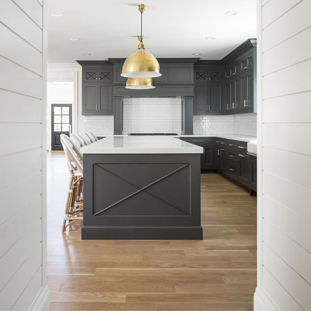 Benjamin Moore Simply White paint color on shiplap in a modern farmhouse kitchen by The Fox Group. #shiplap #benjaminmooresiimplywhite #brasspendants #thefoxgroup #kitchendesign