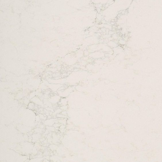 Caesarstone Calacatta Nuvo - a white quartz countertop for kitchens and baths. #caesarstone #calacattanuvo #whitequartz #kitchendesign #countertops