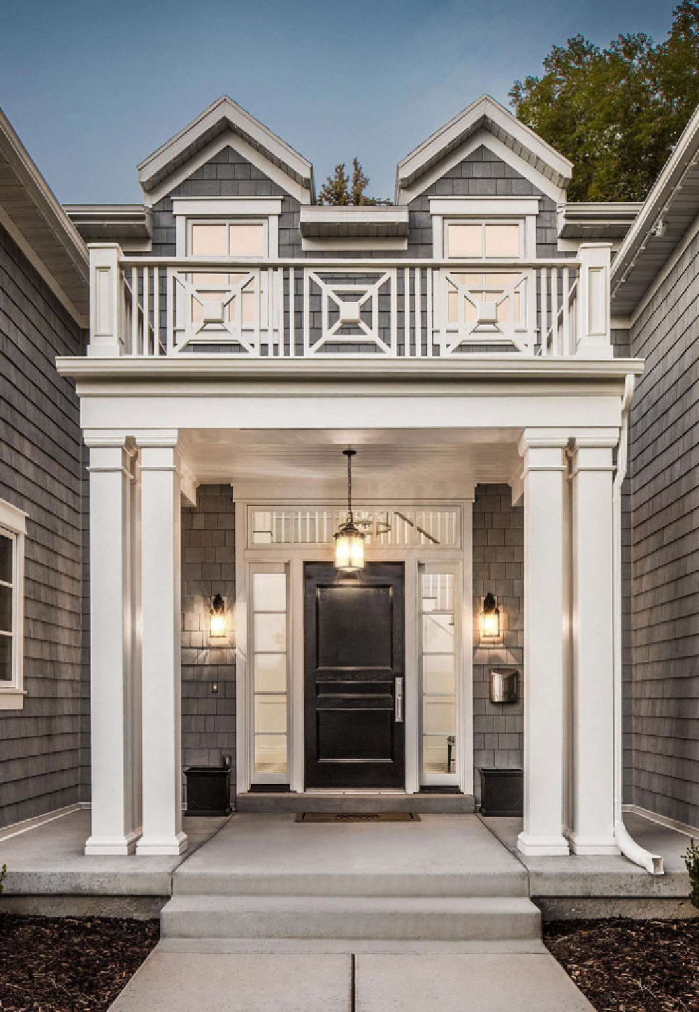 Beautiful architecture and portico railing inspiration from a home by The Fox Group. Come be inspired by more timeless design. #thefoxgroup #houseexterior #portico #architectureinspiration