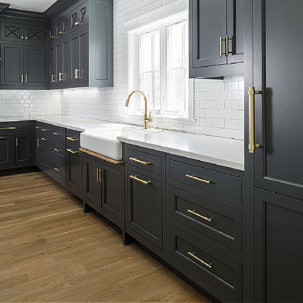 Dark charcoal grey painted cabinets in a classic kitchen by The Fox Group. Come BE INSPIRED by more Timeless Interior Design Ideas, Paint Colors & Furniture Finds! #kitchendesign #thefoxgroup #graycabinets #benjaminmoorecheatingheart #modernfarmhousekitchen